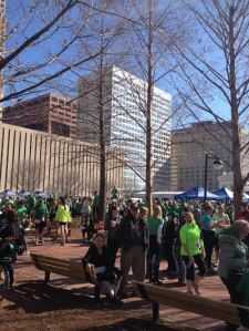 Past the finish line, tents are sent up and people look forward to the Irish Parade that is about to start!