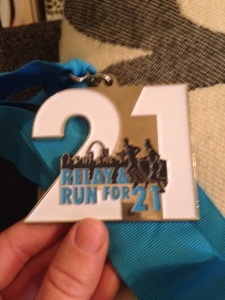 My medal I received at the finish line.