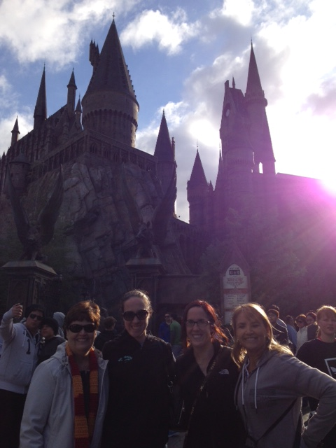 My mom, Kathleen, me, and Aunt Dorie in front of Hogwarts!